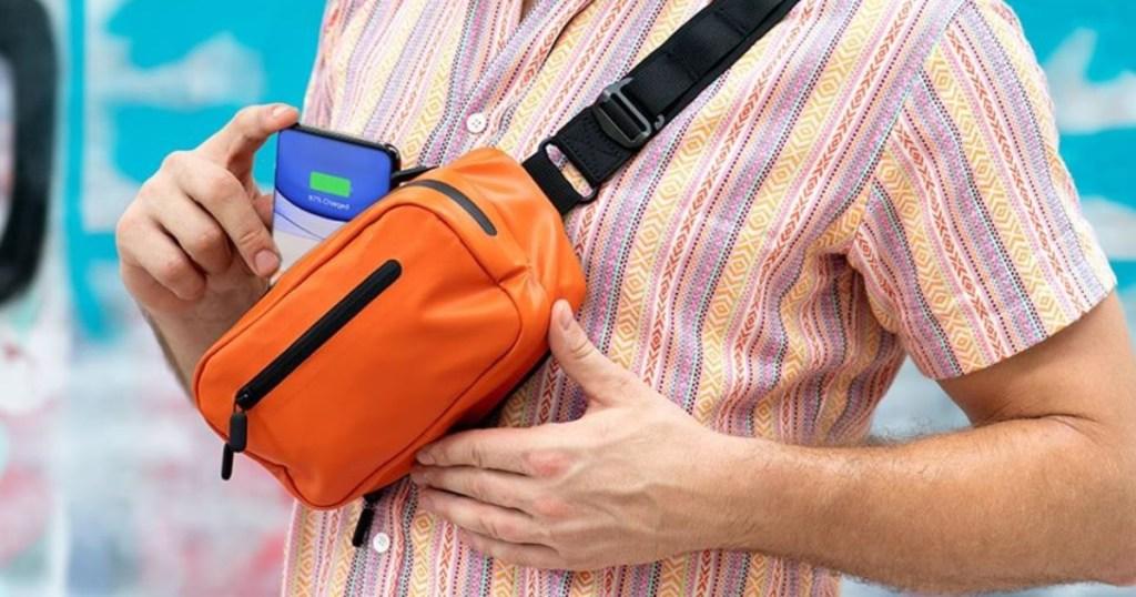man wearing orange fanny pack