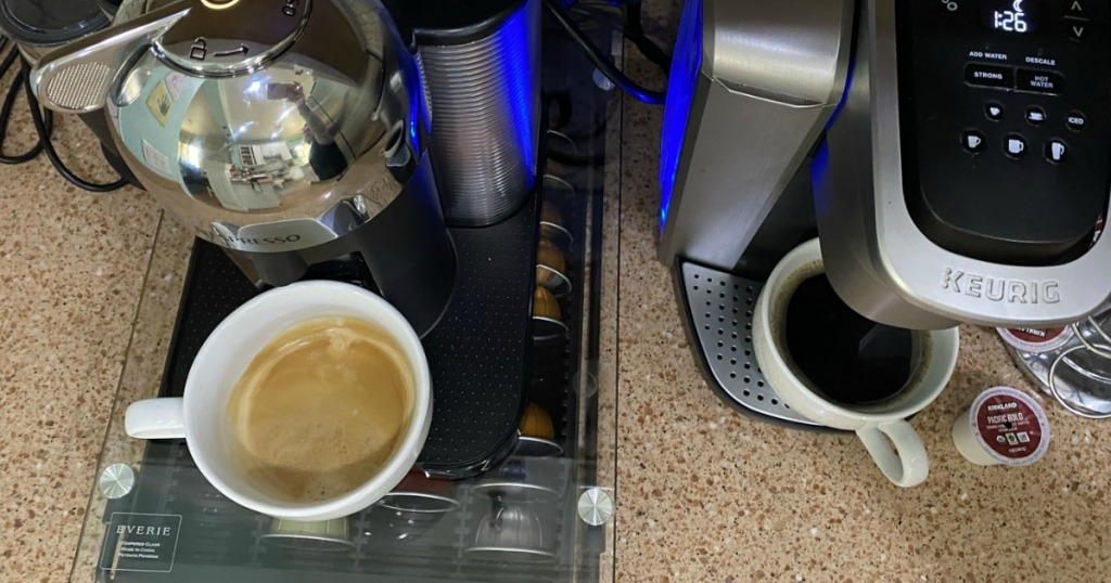 two cups of coffee under machines