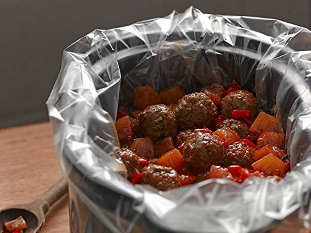 slow cooker with meatballs lined with Reynolds Kitchens Premium Slow Cooker liners