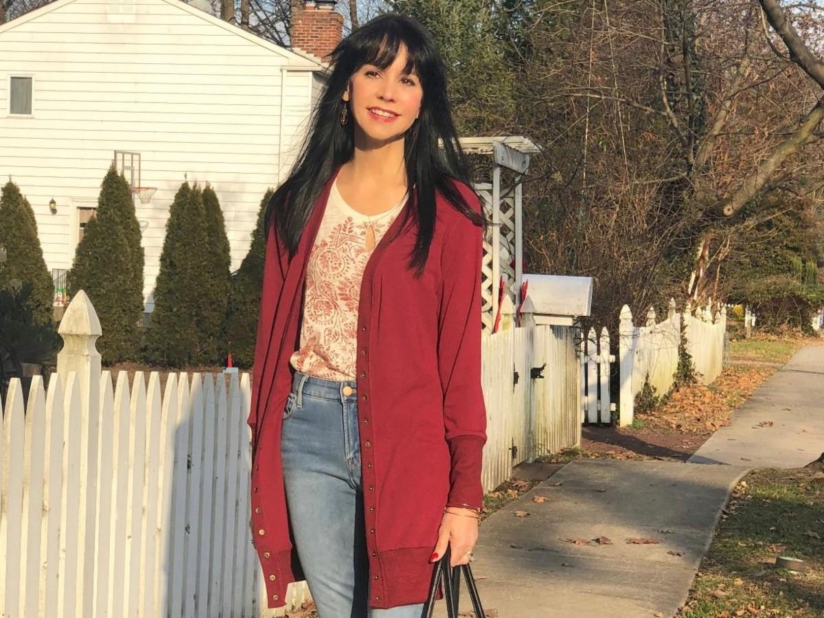 woman wearing dark red cardigan outside