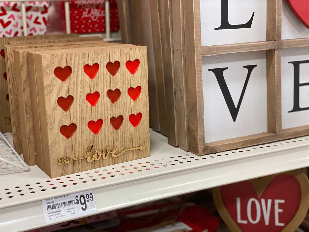wooden table top decor with hearts on a shelf in a craft store
