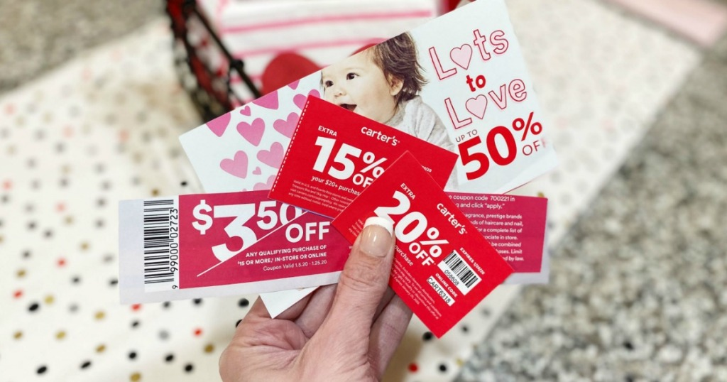 store coupons being held by a womans hand