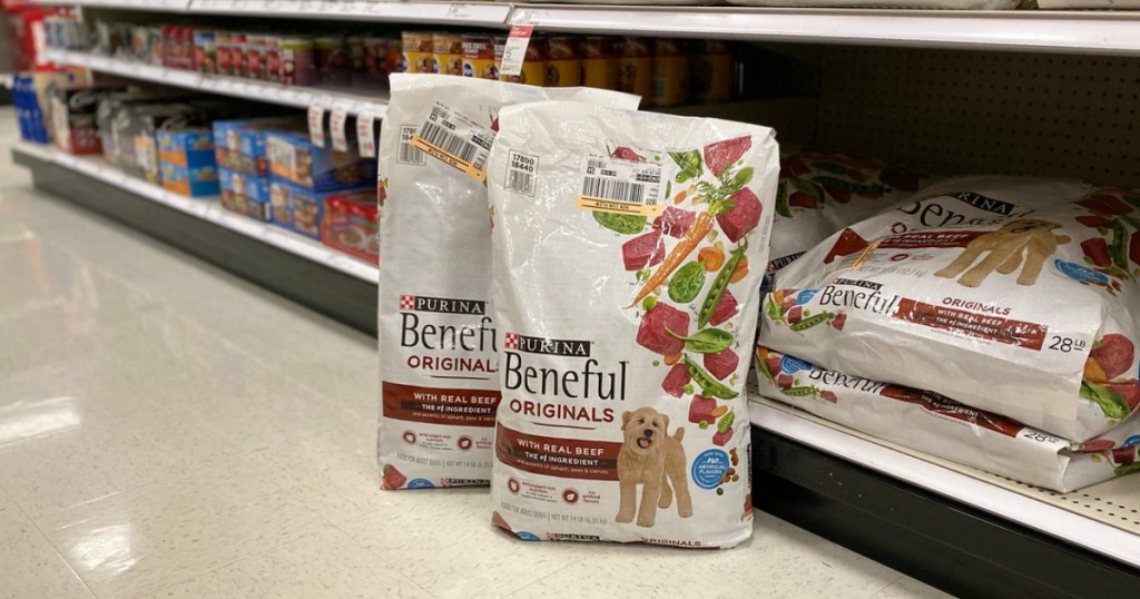 dry dog food bags on the floor in a store