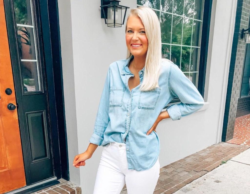 woman wearing chambray shirt and white pants outside