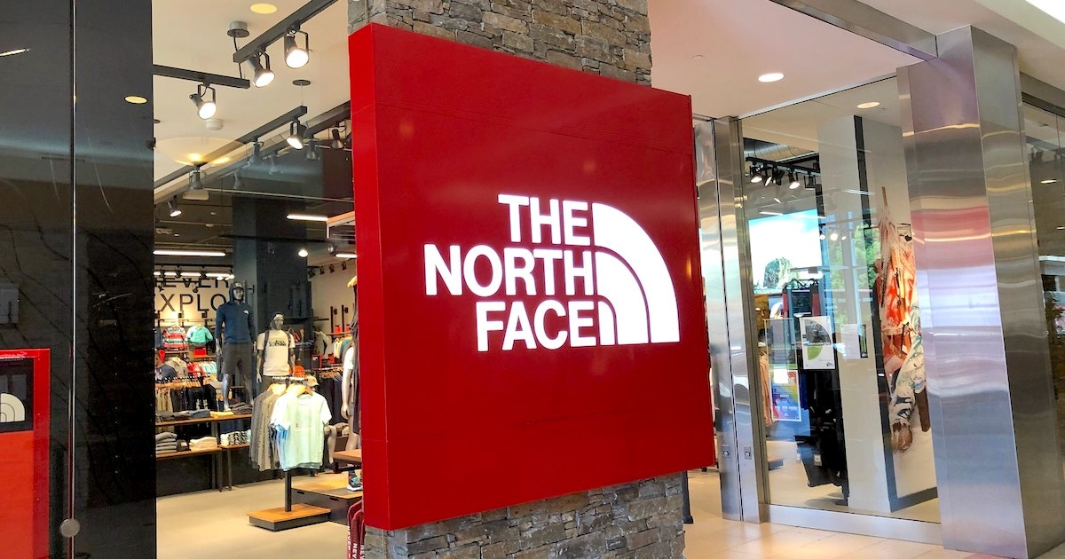 red the north face sign in front of store
