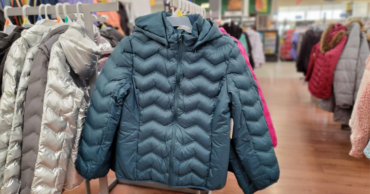 blue puffer jacket hanging in store