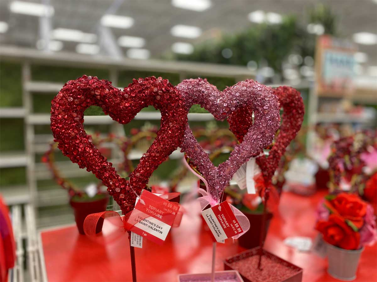 valentine's day tinsel glitter hearts wreath displayed in a craft store