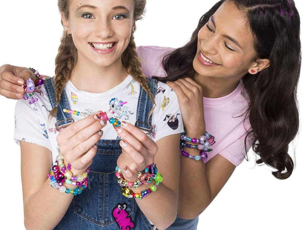 two girls each with twisty petz on their wrists