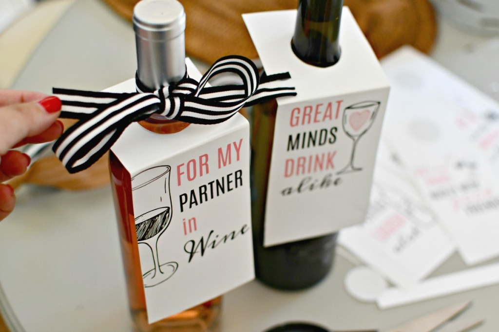 tying a bow and gift tag to bottle