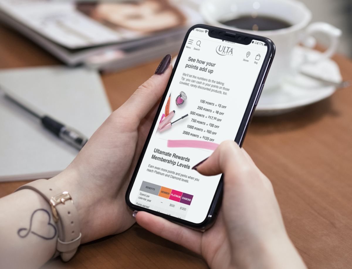 hands holding a phone with ulta points on screen