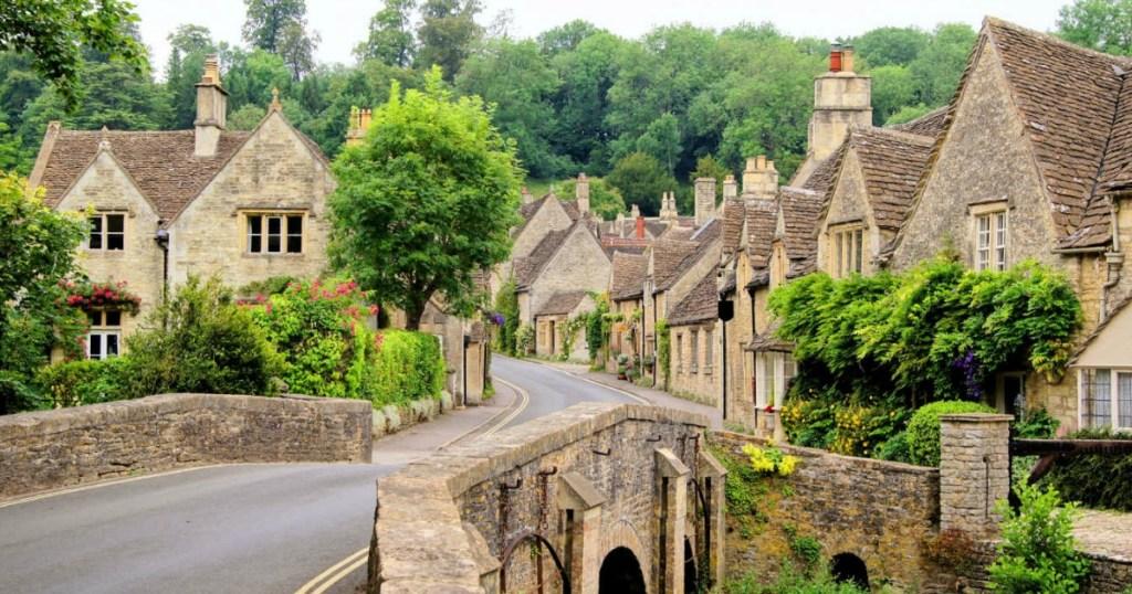old village with brick bridge and greenery