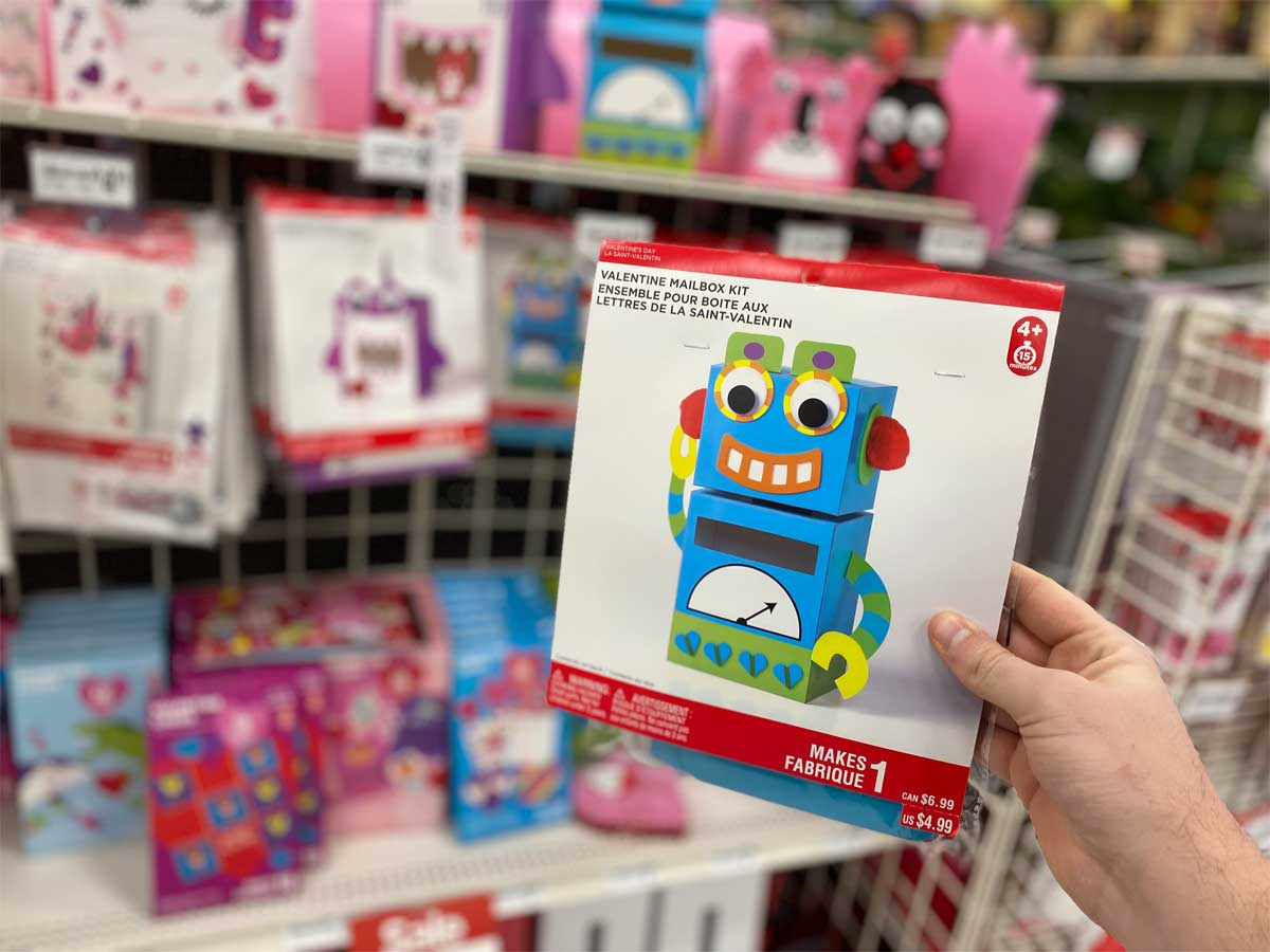 hand holding valentine's day mailbox kit robot in a store by a display
