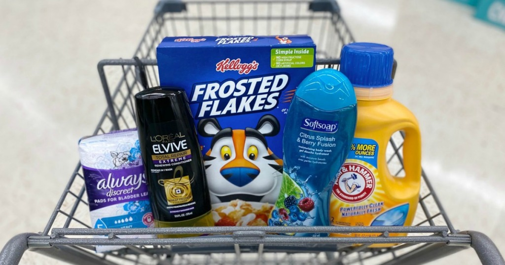 feminine care pads, shampoo, cereal, body wash and laundry detergent in a store shopping cart