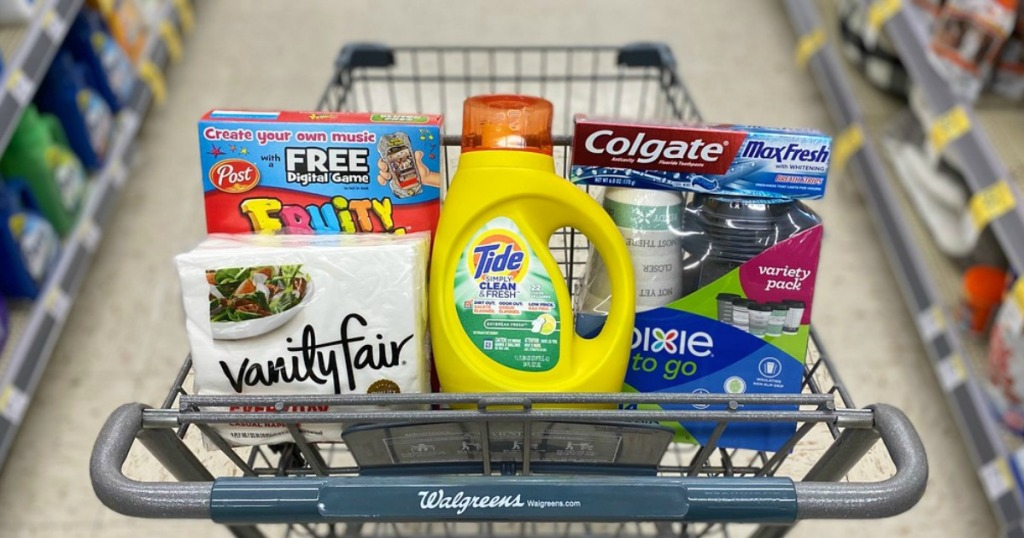 napkins, cereal, laundry detergent, toothpaste and to-go cups in a store shopping cart