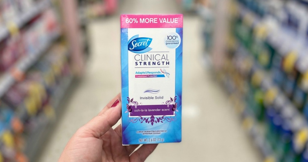 hand holding secret clinical strength deodorant in a store