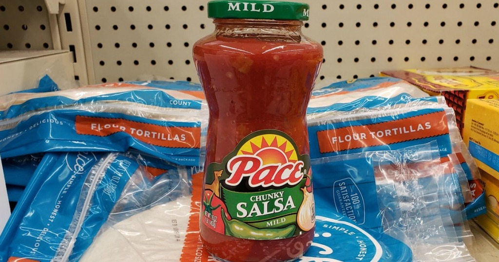 pace salsa on top of flour tortillas in a store