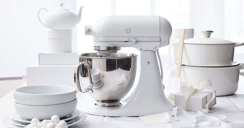 all white kitchenaid mixer with white dishes and presents from best wedding registry