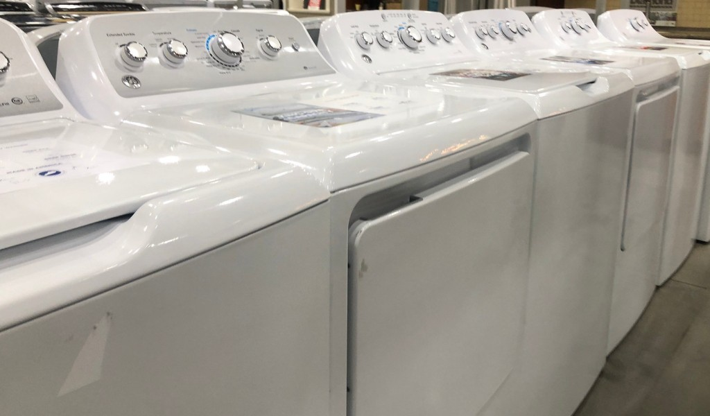 row of white laundry room appliances