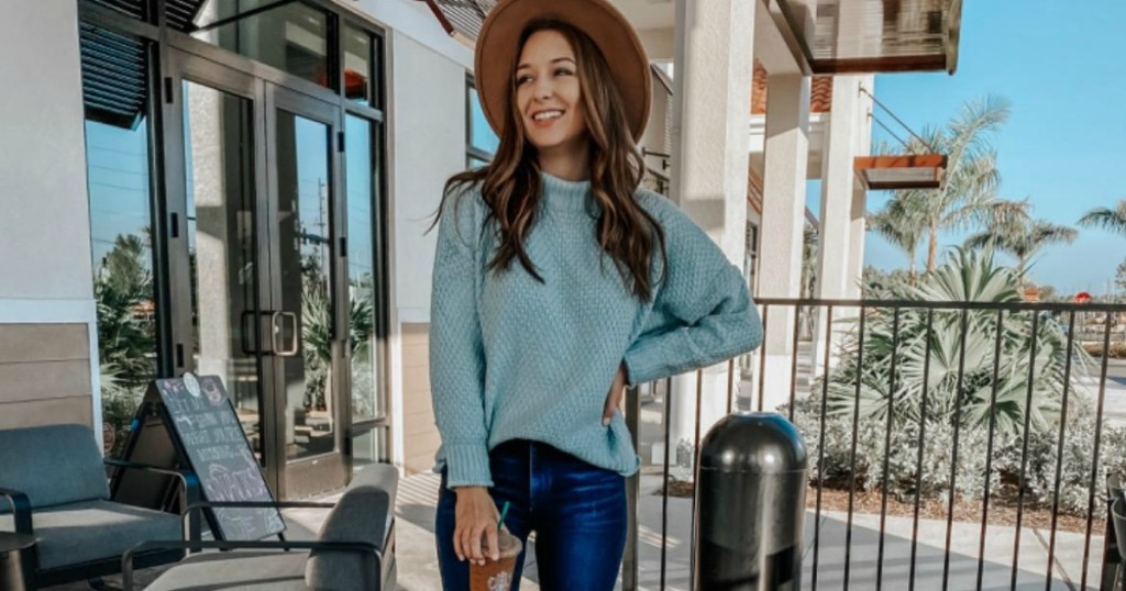 woman wearing turtleneck sweater with jeans and hat