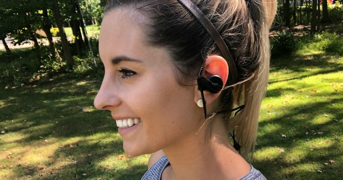 woman with headphones in listening to audiobook