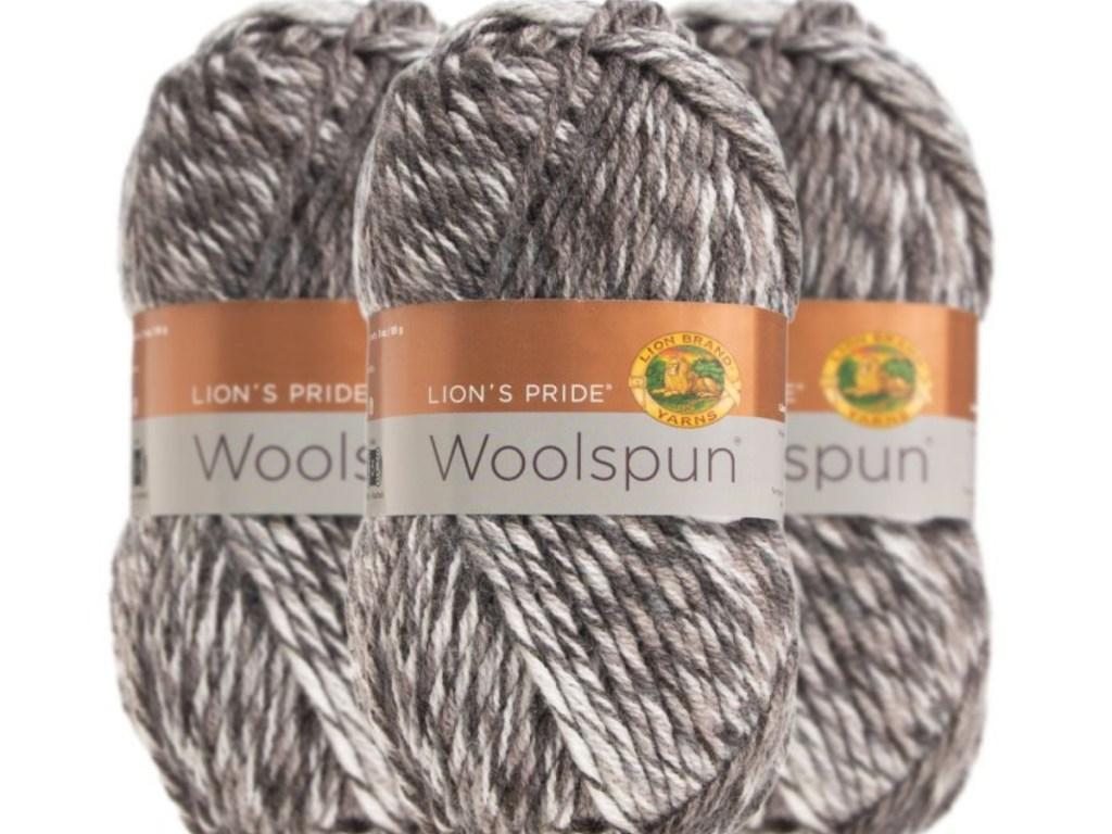 three packs of gray lion's pride woolspun yarn