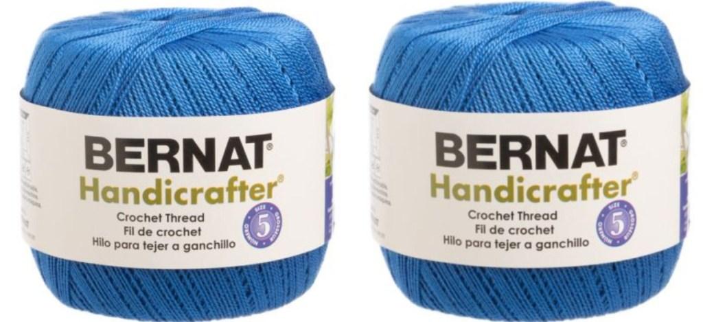 two blue spools of bernat handicrafter crochet thread