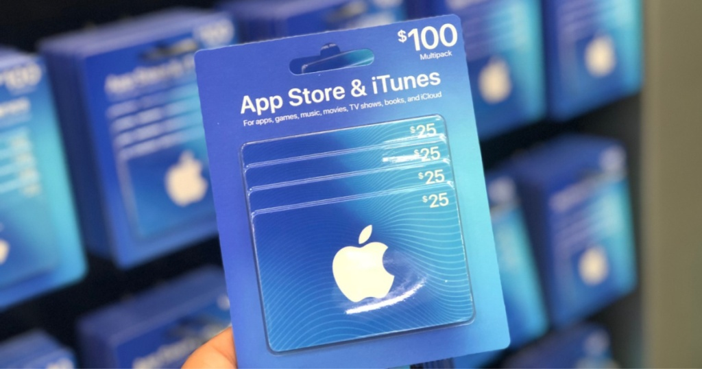 hand holding $100 iTunes Gift Card