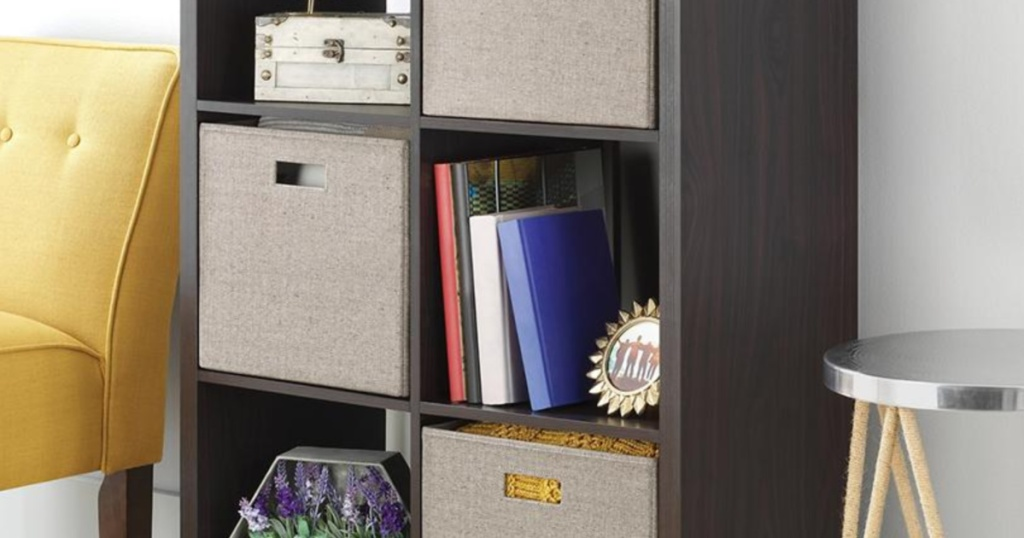 espersso cubes with bins and books and storage on the shelves in living room with yellow couch beside shelf