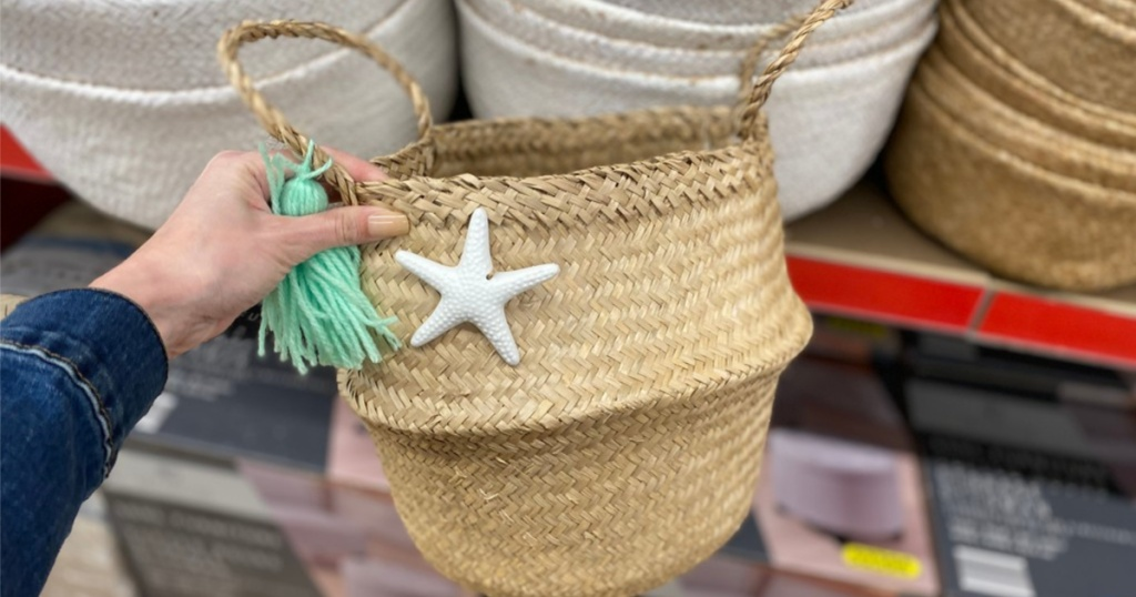 Woman holding straw basket in store
