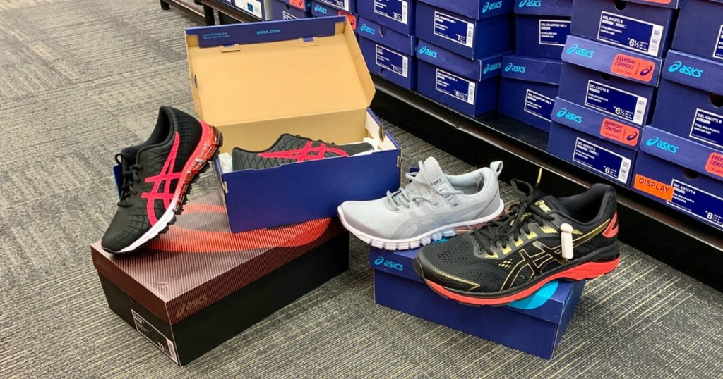 ASICS shoes an shoe boxes on the floor in a store