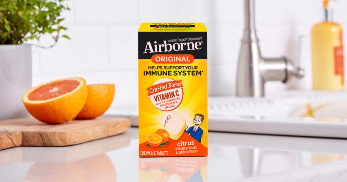 box of Airborne Citrus tablets on kitchen counter with grapefruit sliced on cutting board