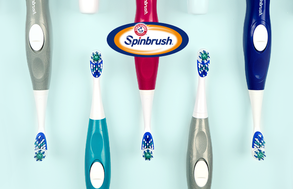 ARm & Hammer spinbrush toothbrushes laying in a row
