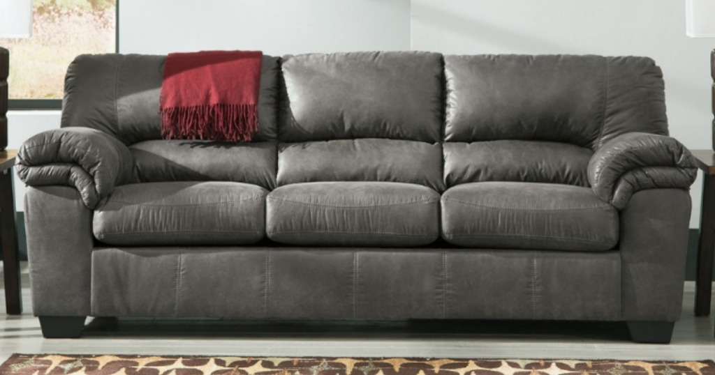 Large dark gray leather sofa in living room