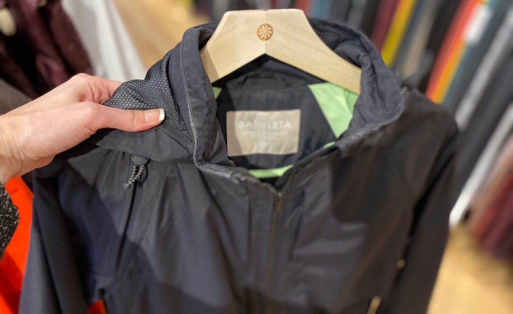 hand holding a Athleta Summit Insulated Parka on a hanger