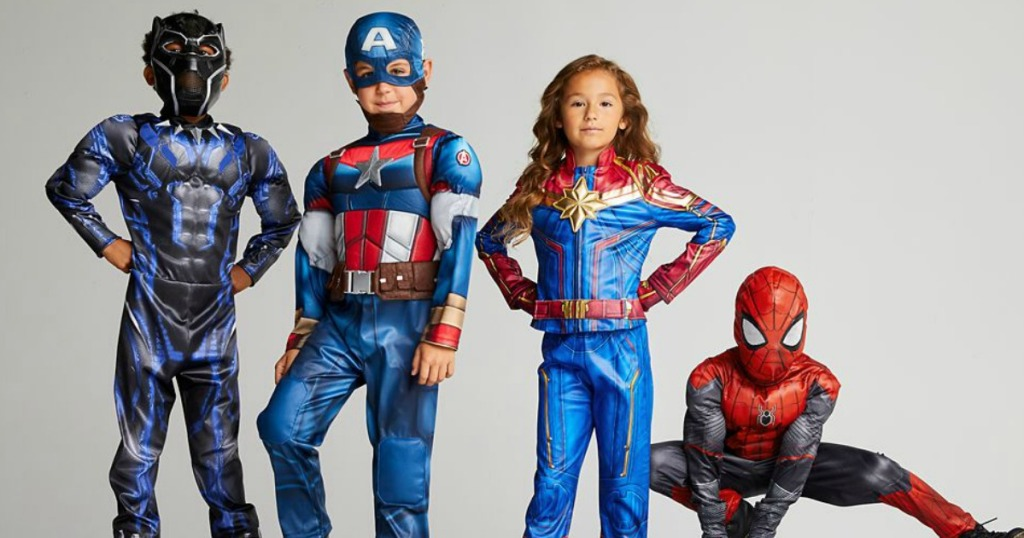 kids standing in Halloween Avengers costumes