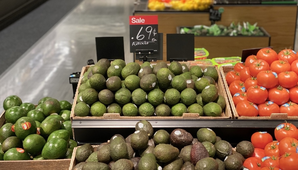display of avocados next to tomatoes at Target