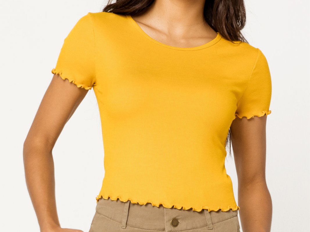 Woman wearing a Yellow women's top