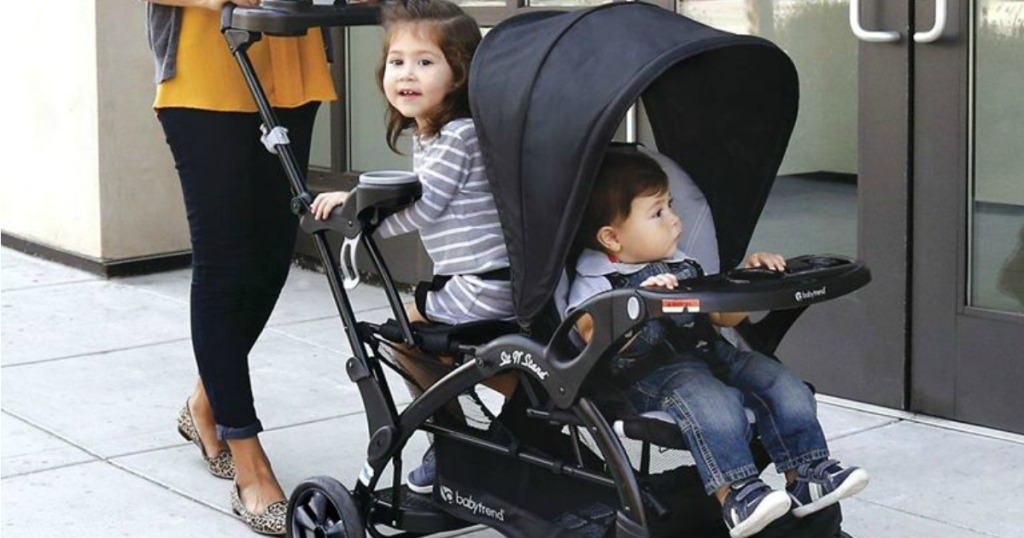 Mom pushing two kids in Baby Trend Sit N Stand
