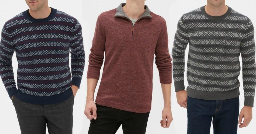 three men standing wearing sweaters