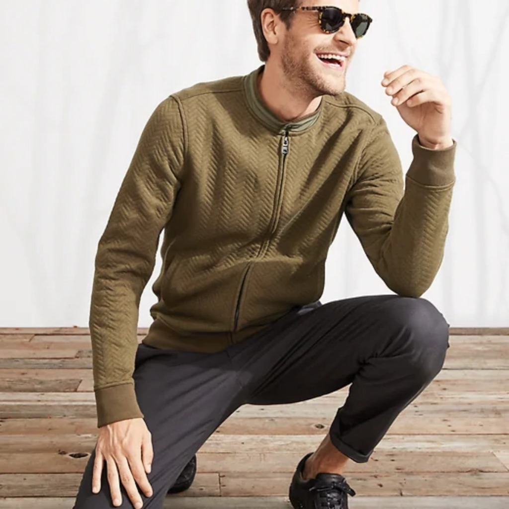 man in sweater and pants crouching down