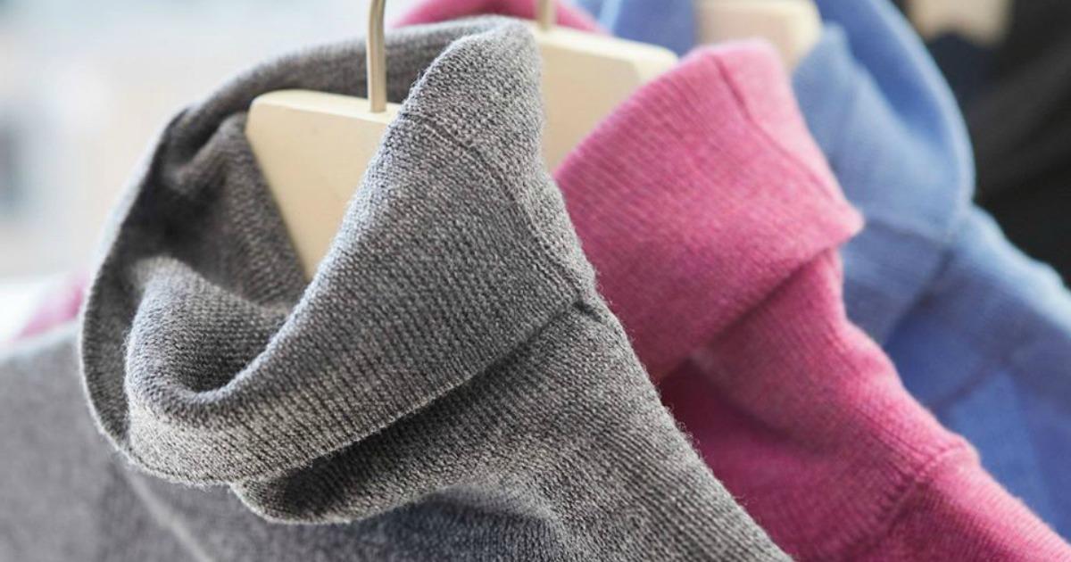Women's turtleneck sweaters on hangers in three colors