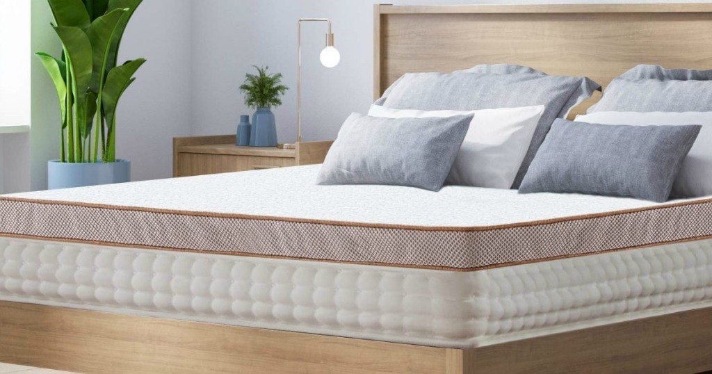 mattress topper and pillows on a bed
