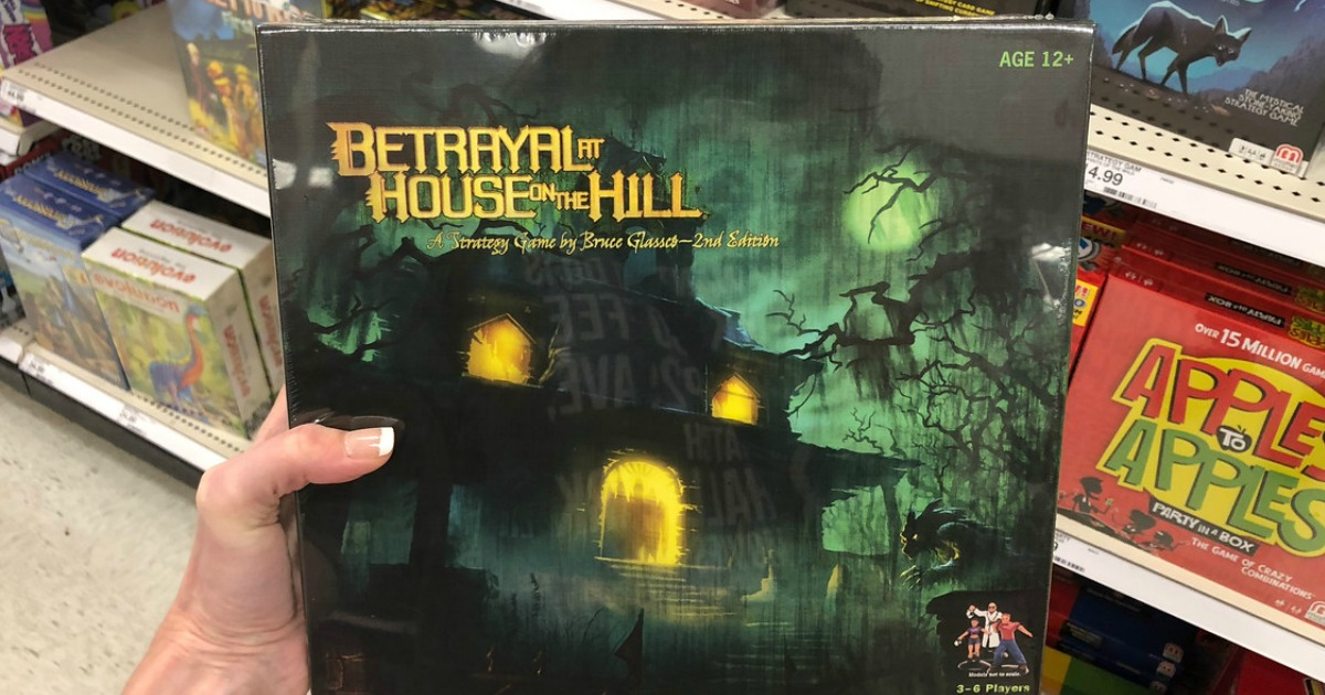 woman holding Betrayal at House on the Hill game