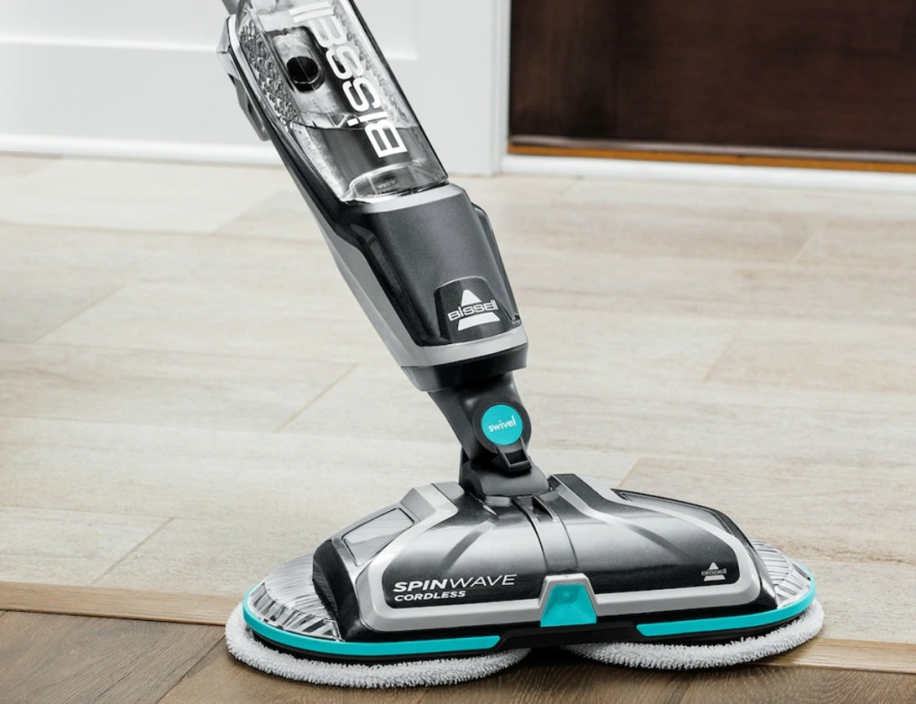 Cordless electronic mop on hardwood floor near carpeting