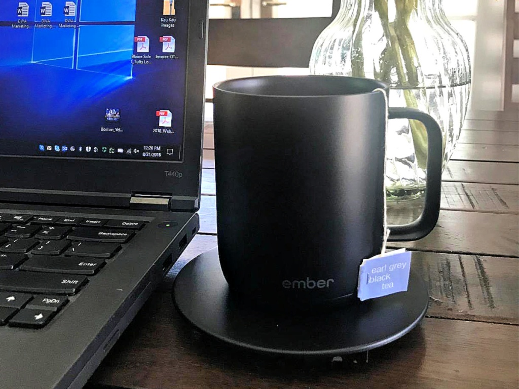 Black Ember Mug on wood table with laptop and vase