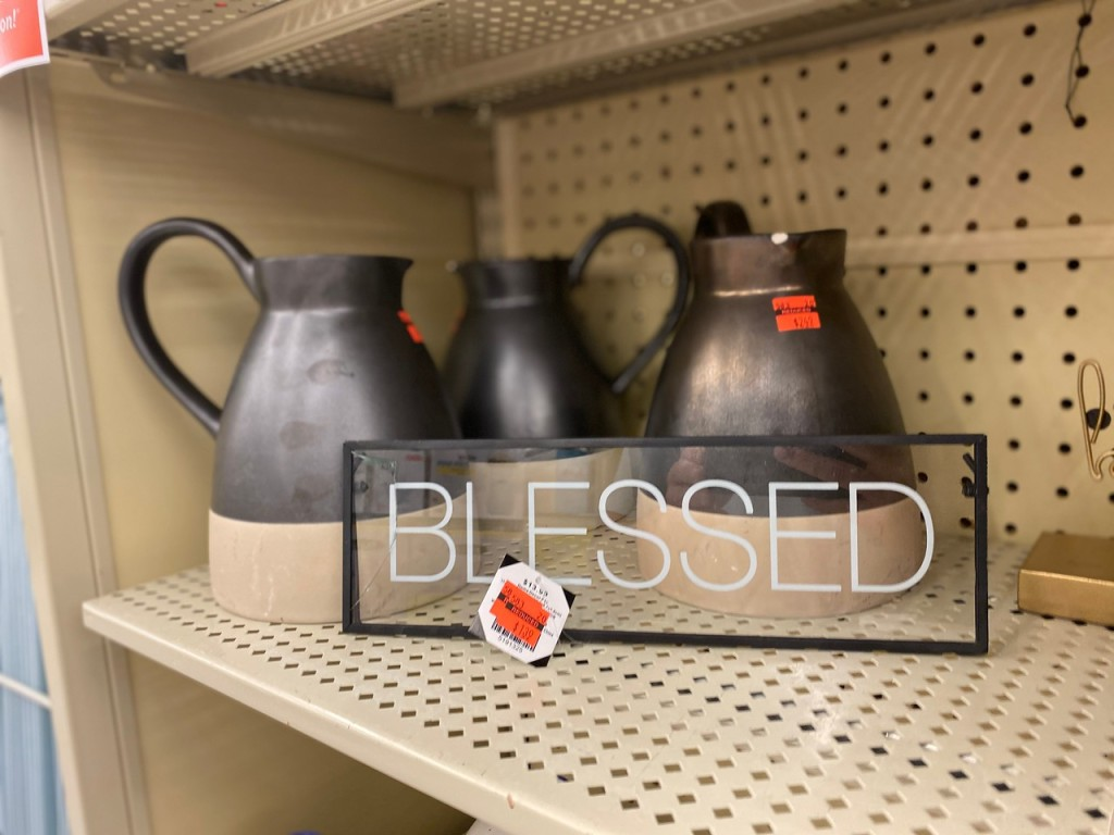 Blessed Sign and Pitchers on store shelf
