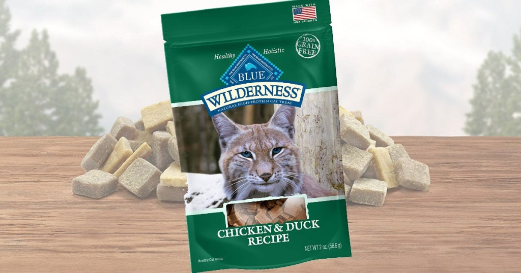 Blue Buffalo brand cat treats in a green bag with a picture of a lynx on the front