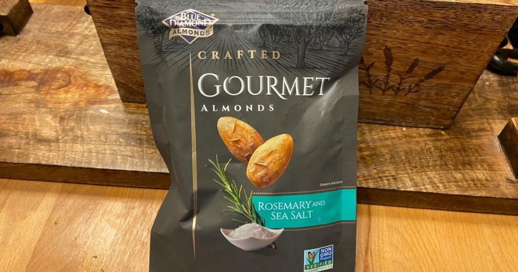 Blue Diamond Rosemary & Sea Salt Almonds on wooden kitchen counter