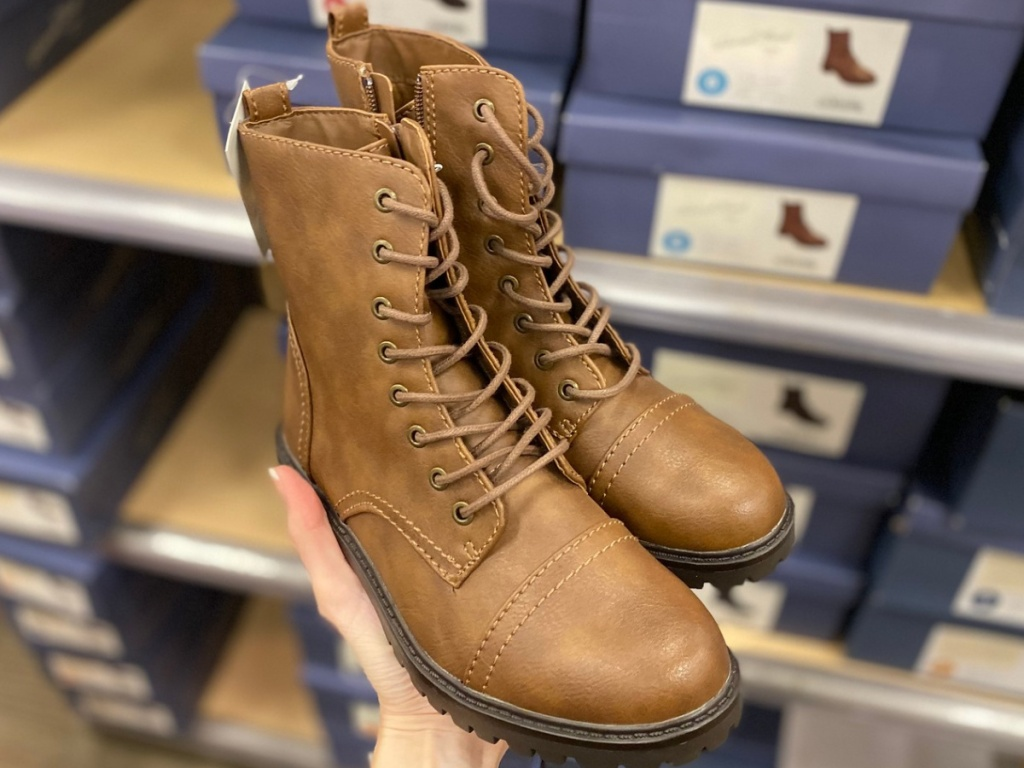 Hand holding women's combat boots at target