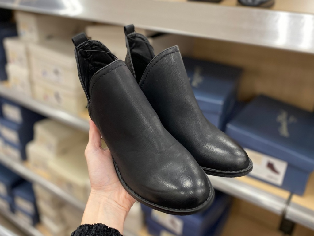 hand holding women's black booties at target